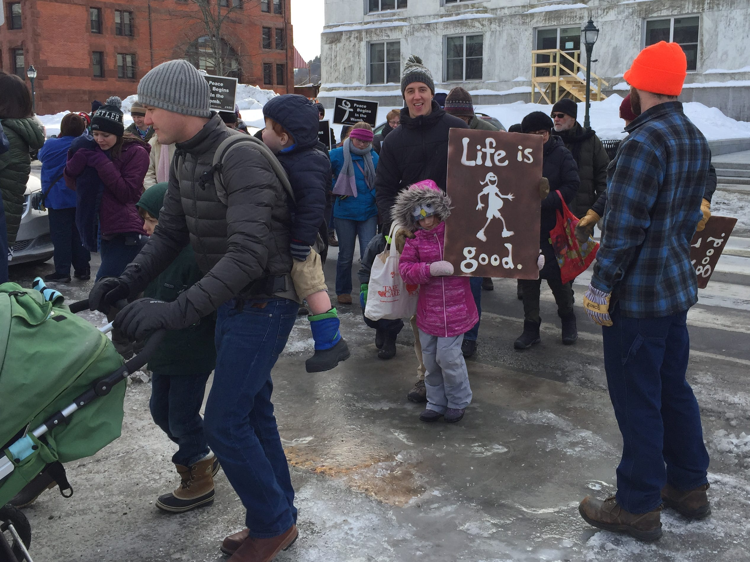 Ben Olson and daughter from Morrisville make it to the Vermont State Capital in Montpelier as an anti-abortion rally gets underway on Jan. 26, 2019.