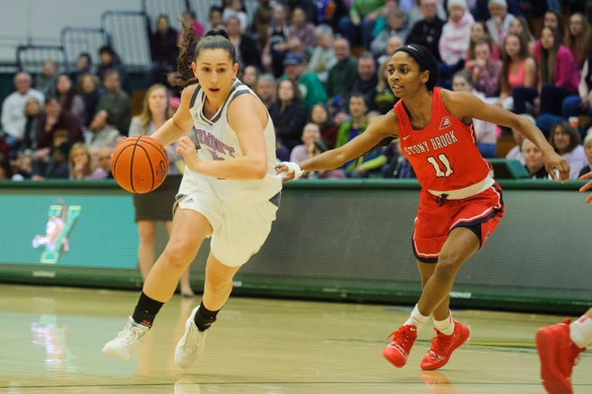 Vermont's Josie Larkins (5) drives to the hoop past Stony Brook's Jerell Matthews (11) during the women's basketball game between the Stony Brook Seawolves and the Vermont Catamounts at Patrick Gym on Saturday afternoon January 26, 2019 in Burlington, Vermont.