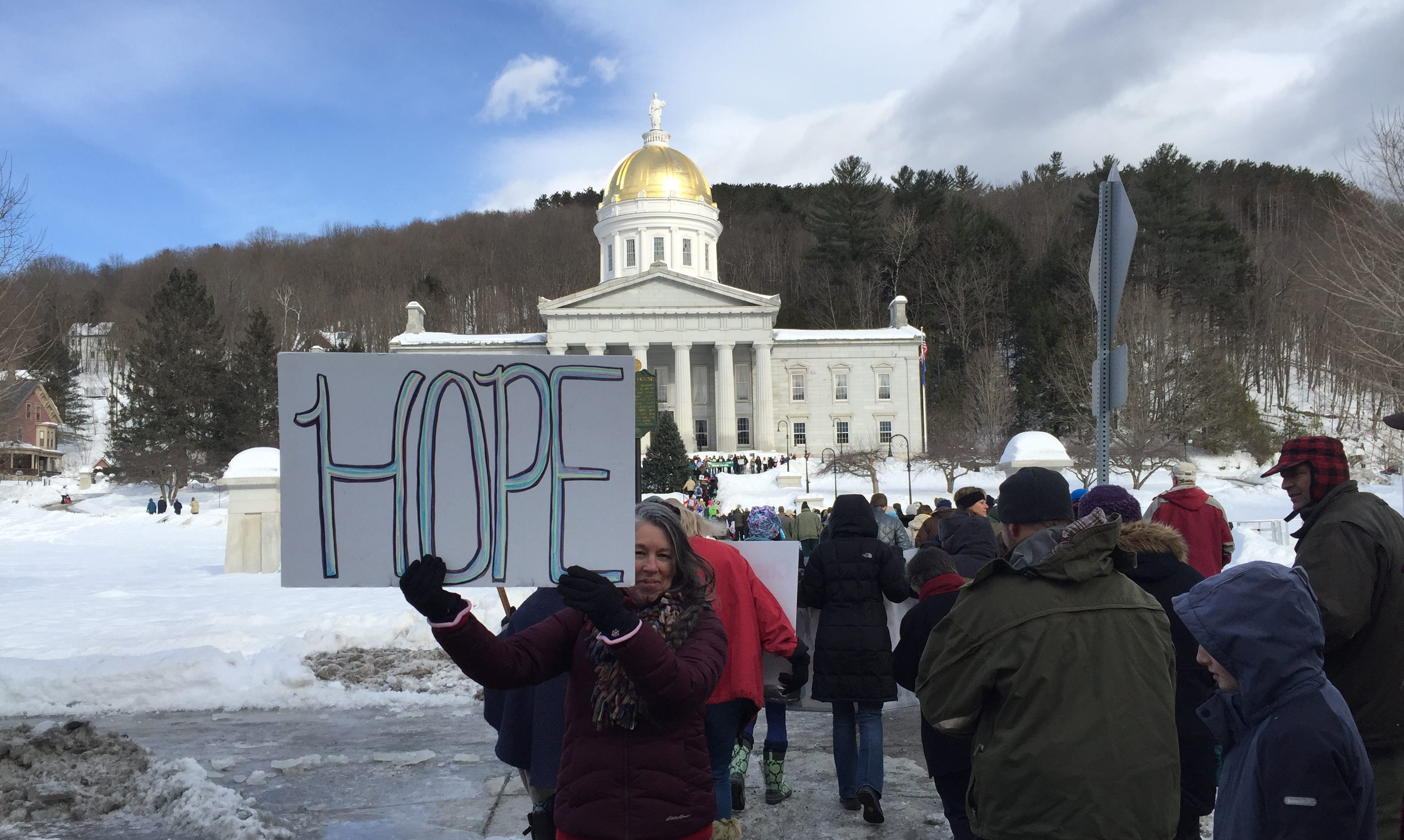 Delia Warnecke of Poultney holds a homemade sign at an anti-abortion rally in Montpelier on Jan. 26, 2019 as hundreds gather.