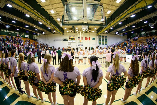 The teams listen to the National Anthem during the women's basketball game between the Stony Brook Seawolves and the Vermont Catamounts at Patrick Gym on Saturday afternoon January 26, 2019 in Burlington, Vermont.