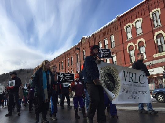 Matthew DeMatties, 17 of Vergennes volunteered to carry the rally banner with Brad Stankiewicz, 15, of Milton lead the anti-abortion march to state house rally in Montpelier on Jan. 26, 2019.