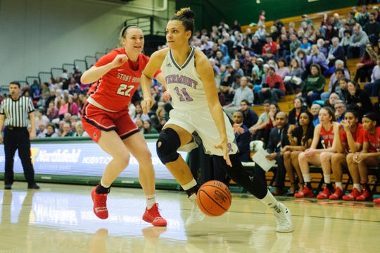 Vermont's Candice Wright (11) drives to the hoop past Stony Brook's McKenzie Bushee (22) during the women's basketball game between the Stony Brook Seawolves and the Vermont Catamounts at Patrick Gym on Saturday afternoon January 26, 2019 in Burlington, Vermont.