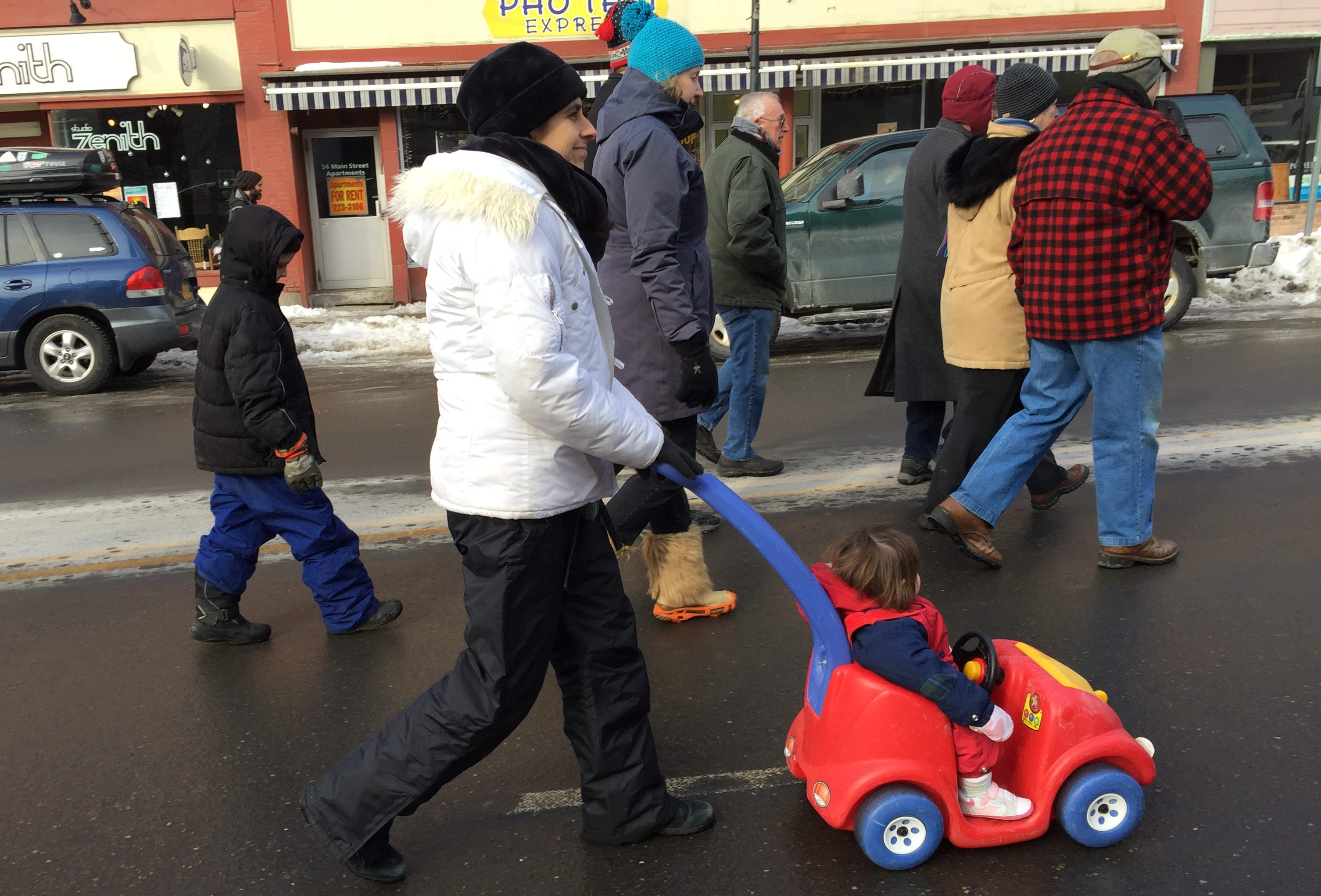 Patty Lawson of Fairfax rolls her child down Main Street in Montpelier as part of an anti-abortion march and rally in the capital on Jan. 26, 2019.