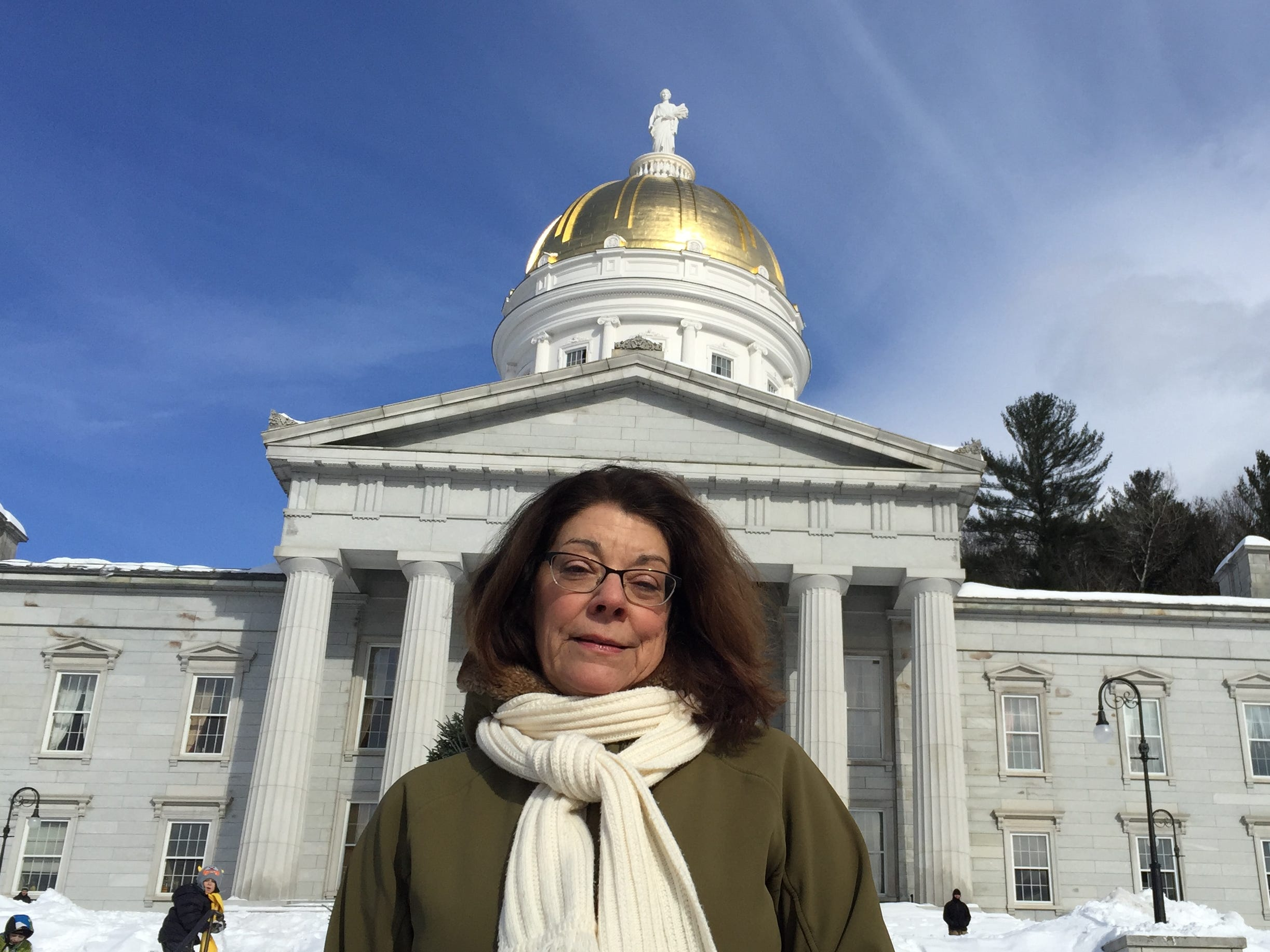 Mary Beerworth, executive director of Vermont Right to Life, takes a moment on the steps of the Vermont State House, before joining anti-abortion marchers inside on Jan. 26, 2019.