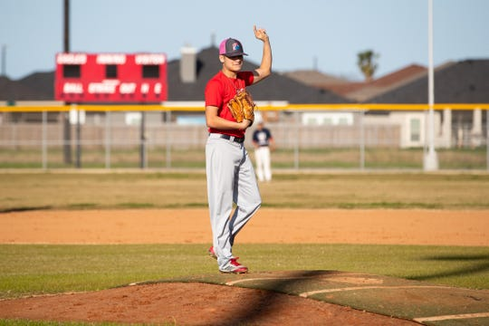 Veterans Memorial pitcher JoJo Villarreal during the first day high school baseball teams can practice in Texas at the Veterans Memorial High School baseball field on Friday, Jan. 25, 2019.