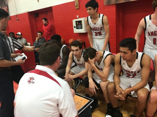 IWA earns key TAPPS District 6-5A win against rival St. John Paul II in high school boys basketball.