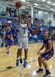 Chillicothe junior Tre Beard makes a layup to score for Chillicothe Friday night at Chillicothe High School. The Cavaliers defeated McClain 58-39.