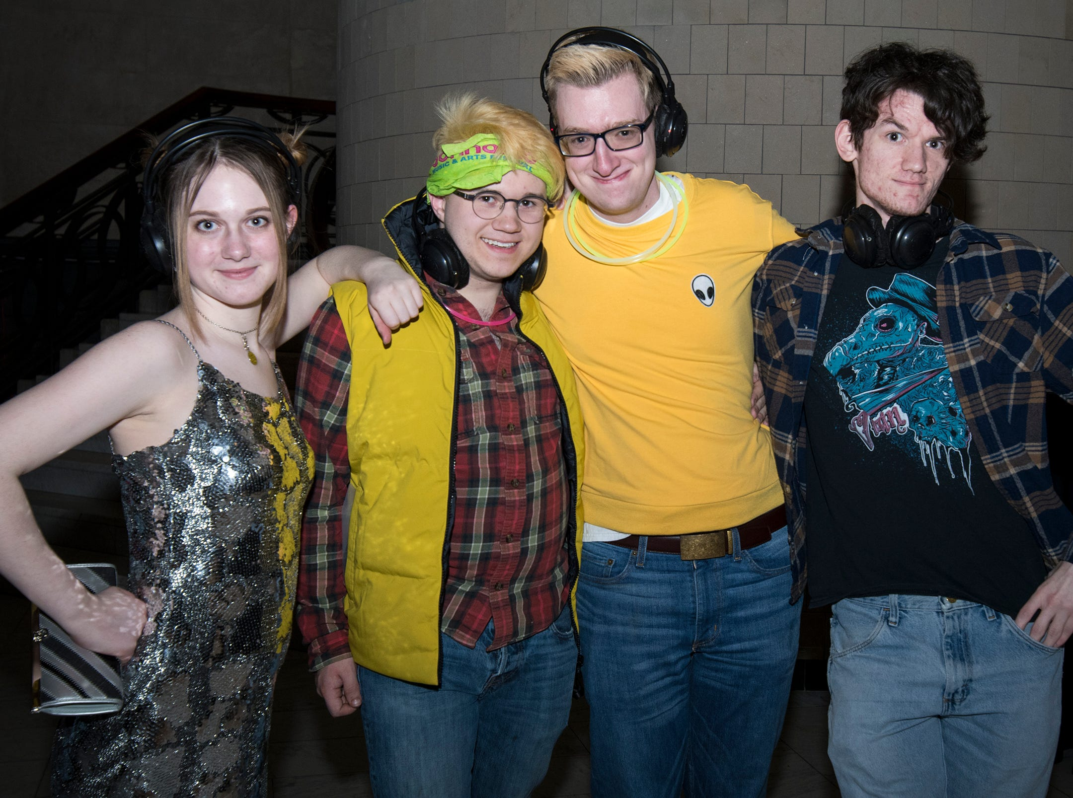 Rowan Threnody, Nicholai Lekson, TJ Snape and Kameron Franklin attend a 90s-themed silent disco during Art After Dark at the Cincinnati Art Museum Friday, January 25, 2019 in Cincinnati, Ohio.