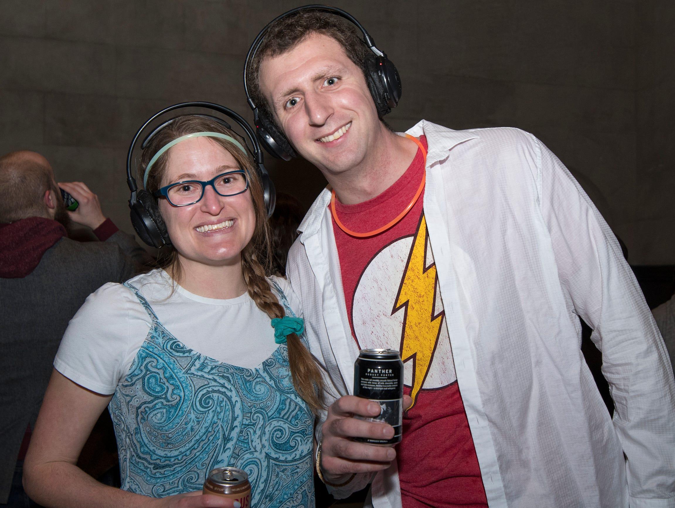 Jennifer and Matt Steinhardt of Mt. Adams attend a 90s-themed silent disco during Art After Dark at the Cincinnati Art Museum Friday, January 25, 2019 in Cincinnati, Ohio.