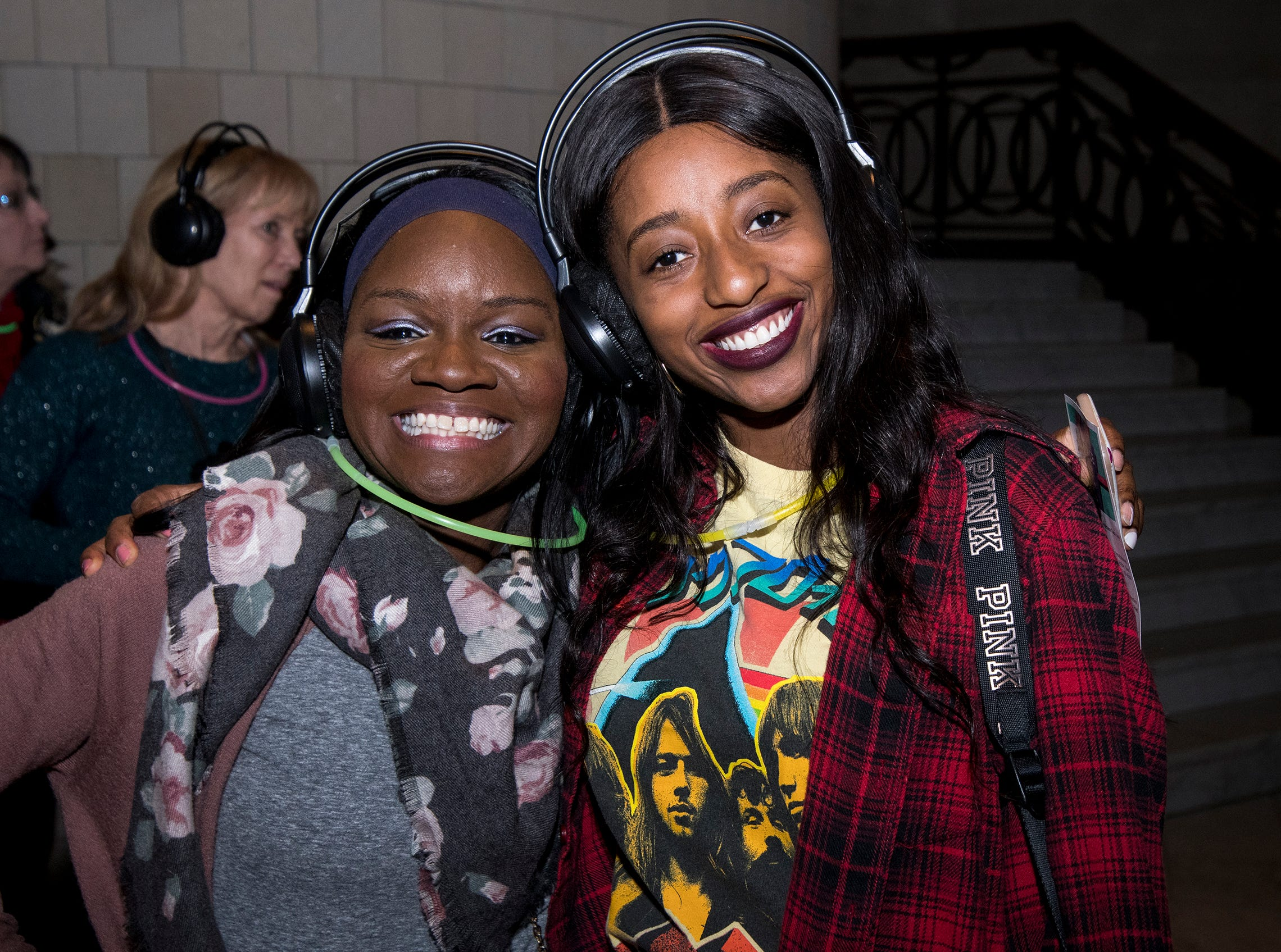 Mamawa Konuwa and Patrice Friemoth attend a 90s-themed silent disco during Art After Dark at the Cincinnati Art Museum Friday, January 25, 2019 in Cincinnati, Ohio.