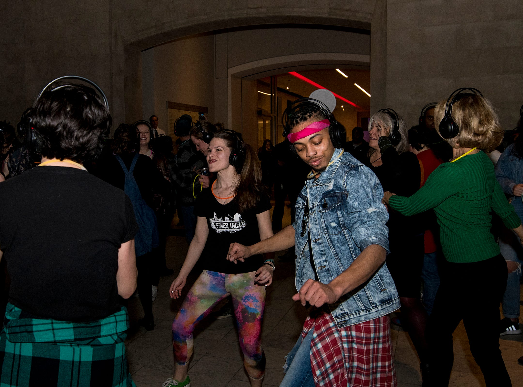 Dancers from Pones Inc. take the dance floor during a 90s-themed silent disco at Art After Dark at the Cincinnati Art Museum Friday, January 25, 2019 in Cincinnati, Ohio.