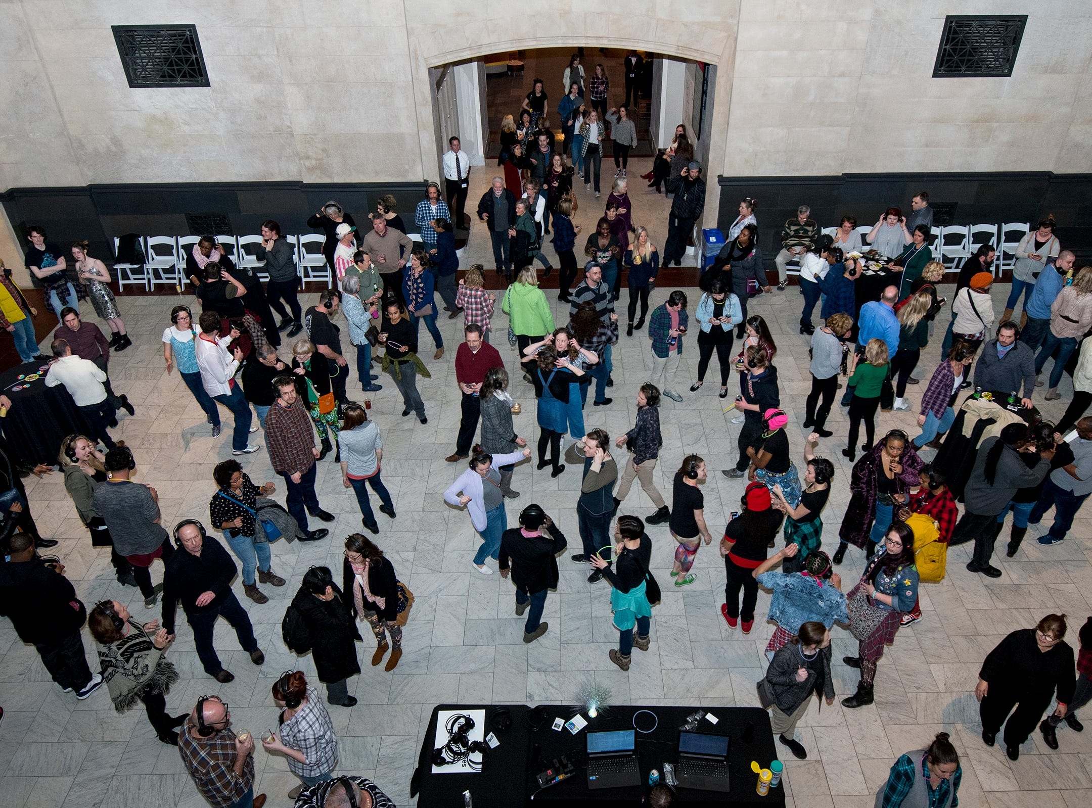 Hundreds attend a 90s-themed silent disco during Art After Dark at the Cincinnati Art Museum Friday, January 25, 2019 in Cincinnati, Ohio.