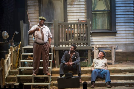 """For Troy Maxson (L, played by """"ranney""""), Friday after work is a time to kick back with a pint of gin and enjoy the company of his son Lyons (Darnell Pierre Benjamin, center) and his best friend Bono (Sylvester Little, Jr., right). It's a scene that is replayed many times in the Cincinnati Shakespeare Company production of August Wilson's """"Fences,"""" which runs through Feb. 16."""