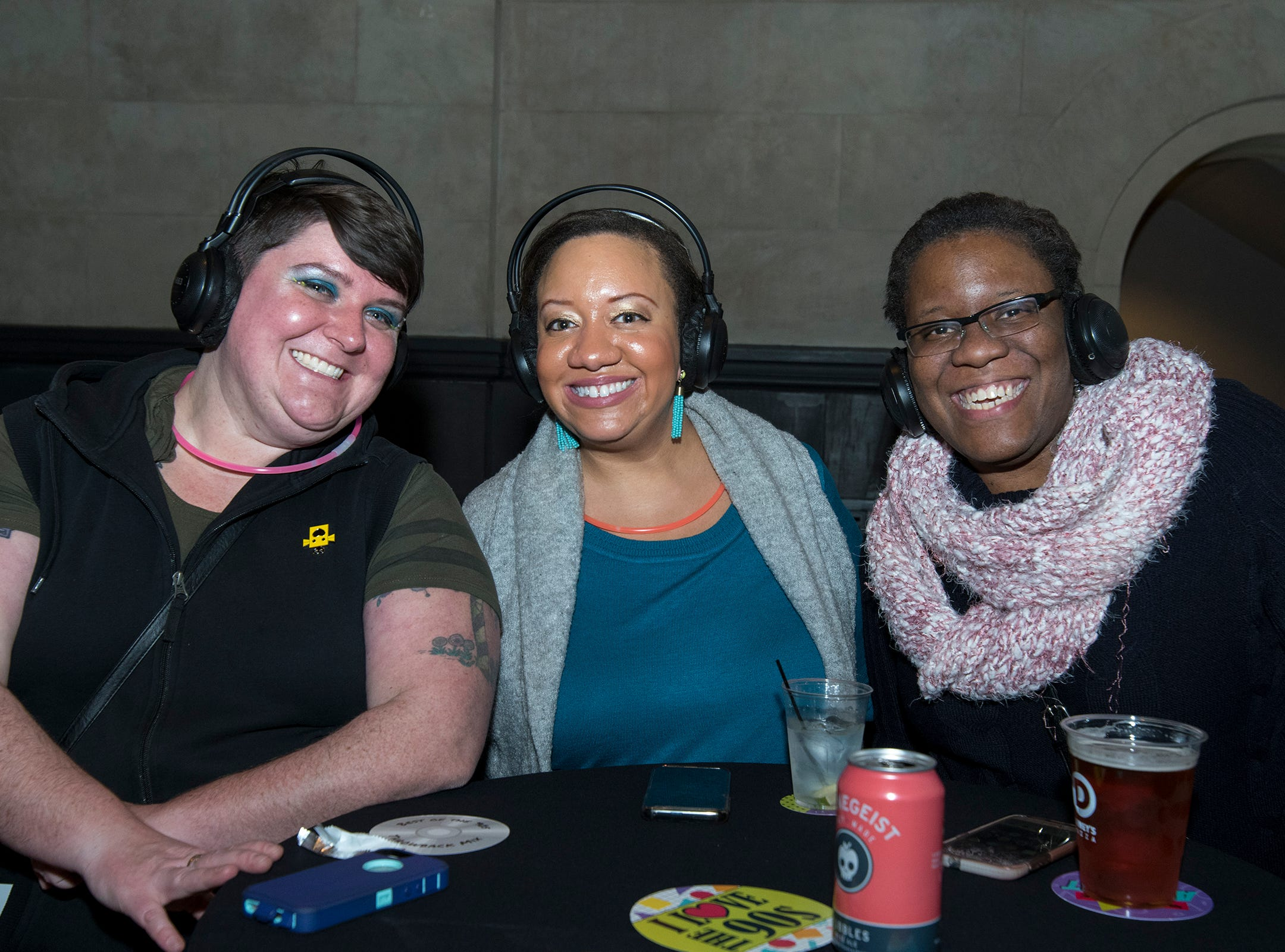 Tina Mahle, Michanne Davis and Alana Calhoun attend a 90s-themed silent disco during Art After Dark at the Cincinnati Art Museum Friday, January 25, 2019 in Cincinnati, Ohio.