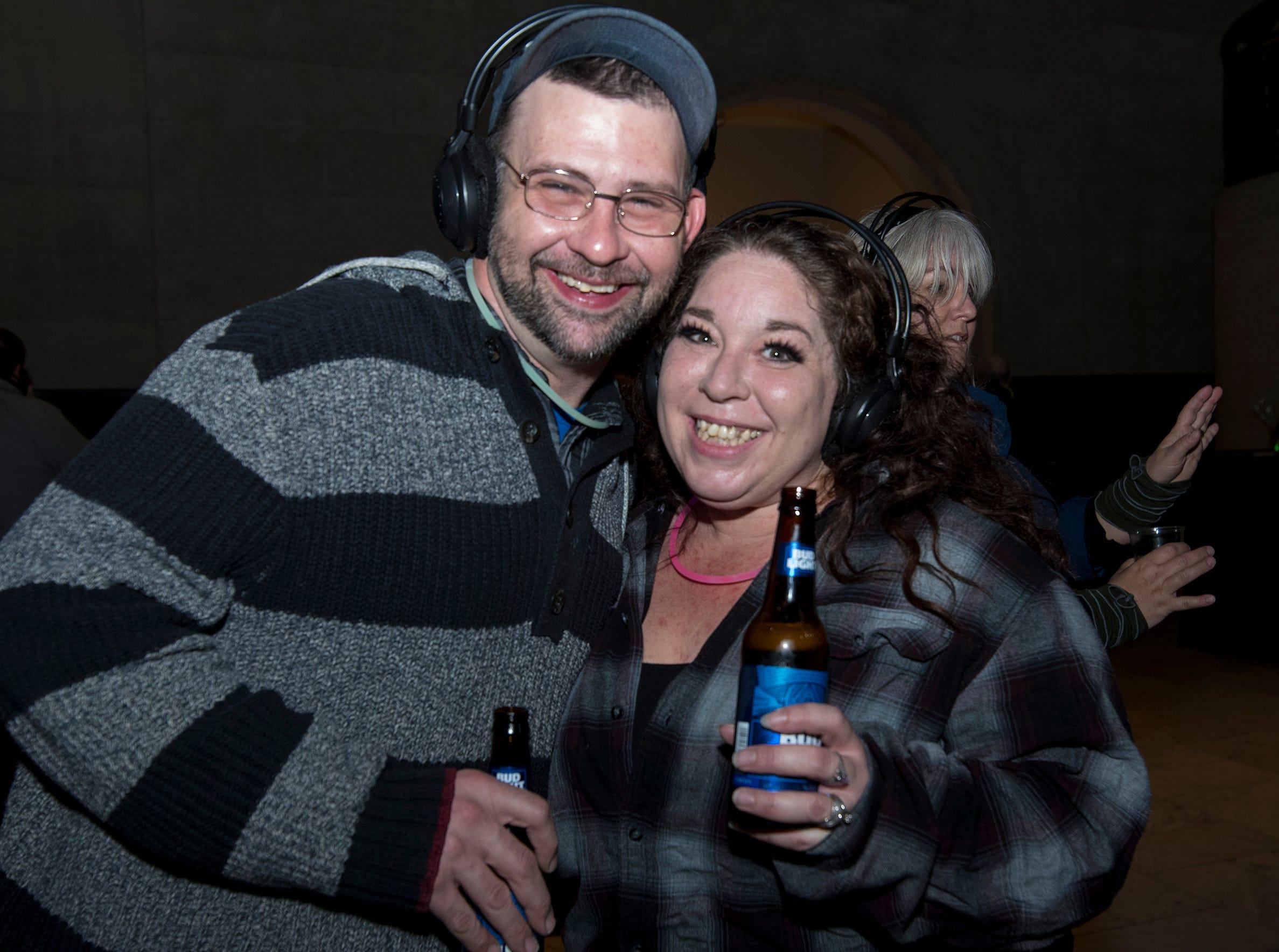 Darren and Jennifer Warman of Mt. Healthy attend a 90s-themed silent disco during Art After Dark at the Cincinnati Art Museum Friday, January 25, 2019 in Cincinnati, Ohio.