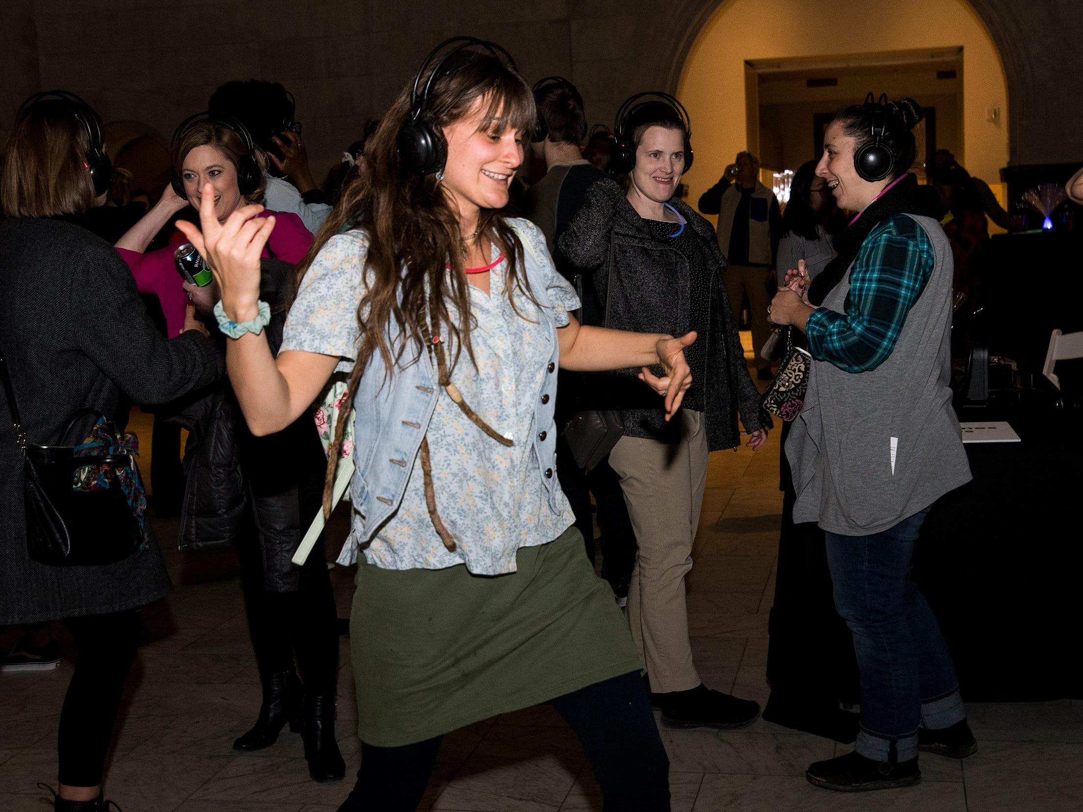 Nichole Mix dances during a 90s-themed silent disco at Art After Dark at the Cincinnati Art Museum Friday, January 25, 2019 in Cincinnati, Ohio.