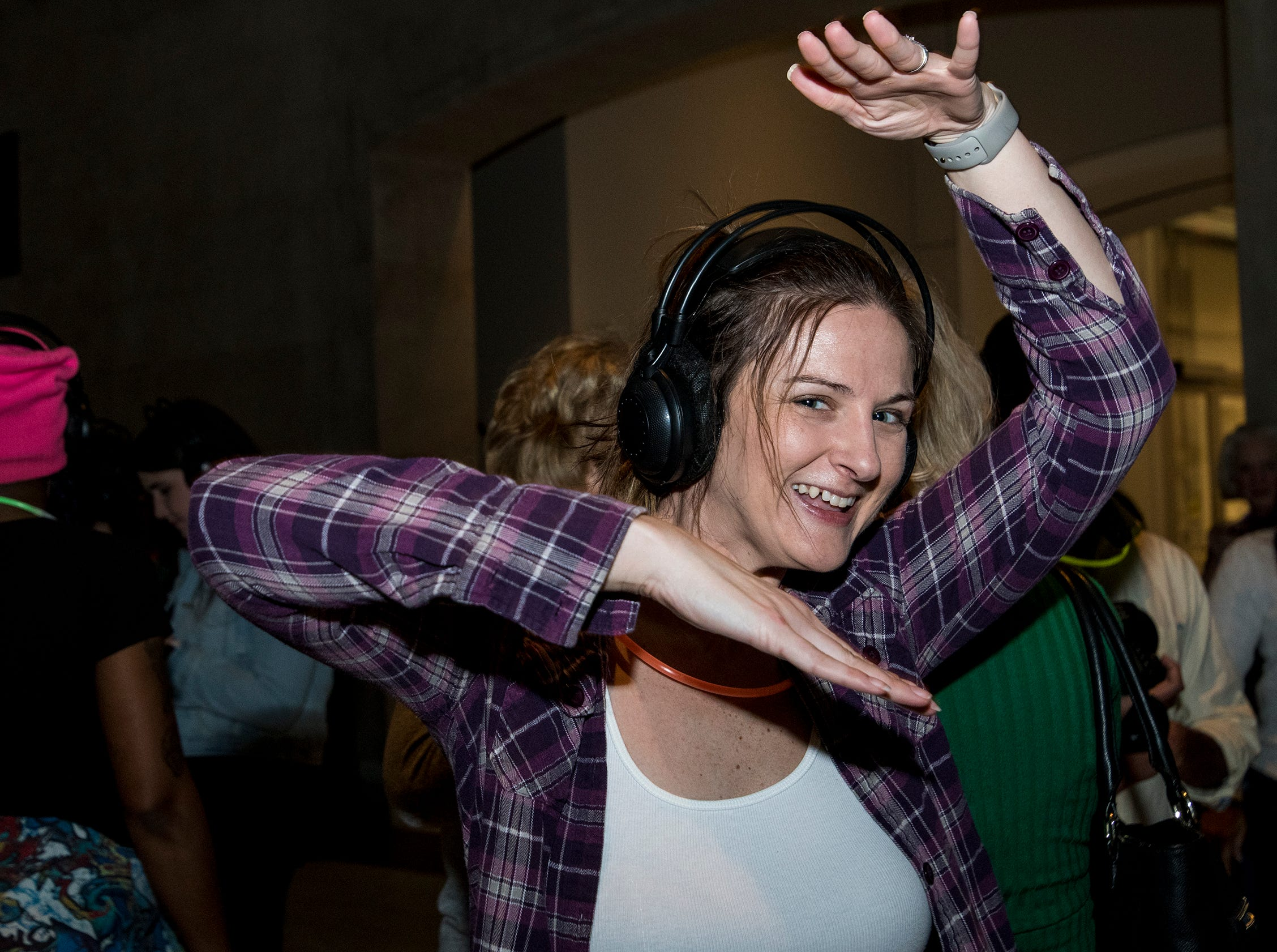 Kirsty Beagle of Madisonville Vogues during the 90s-themed silent disco at Art After Dark at the Cincinnati Art Museum Friday, January 25, 2019 in Cincinnati, Ohio.