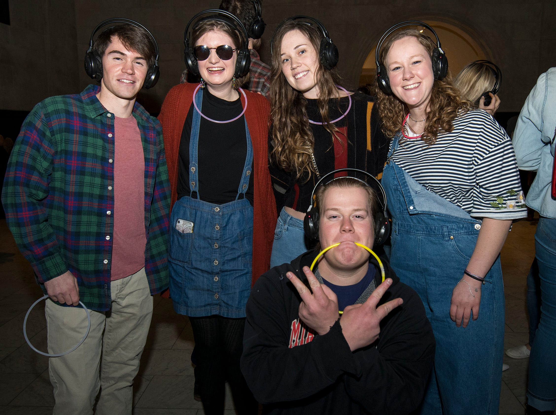 Al Cliffel, Joanie Findley, Lily Henry, Ravenna Rutledge and Paul Findley attend a 90s-themed silent disco during Art After Dark at the Cincinnati Art Museum Friday, January 25, 2019 in Cincinnati, Ohio.