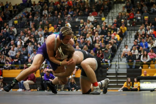 Ankeny Centennial's Nic Leo wrestles Johnston's Tyler Christensen in the opening round of the CIML Invitational on Jan. 25 at Southeast Polk High School. Leo won by technical fall in 5:50. He went on beat Des Moines East's Matthew Scott, 4-0, in the 182-pound final.
