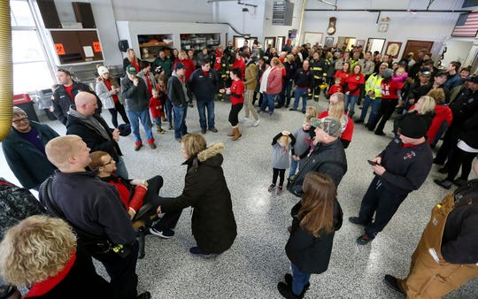 Family, friends and local residents gather during a homecoming celebration  Clinton firefighter Adam Cain at the Central Fire Station, Friday, Jan. 25, 2019, in Clinton, Iowa. Cain was released from the University of Iowa Hospitals on Friday and driven to the Central Fire Station in Clinton for the first time since being seriously injured while battling a grain bin fire at the Archer Daniels Midland plant in Clinton, on Jan. 5.
