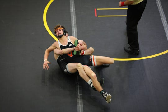 Ankeny Centennial's Ben Monroe controls Valley's Noah Micka in the 132-pound quarterfinals at the CIML Invitational on Friday night at Southeast Polk High School. Monroe beat Micka by technical fall, then went on to place first in his weight class.