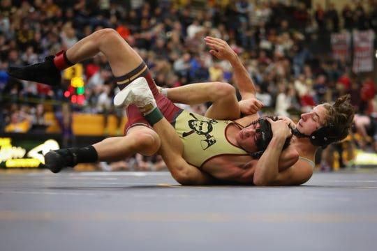 Des Moines Lincoln's Ben Alvarado wrestles with Southeast Polk's Carson Martinson the CIML Invitational at Southeast Polk High School on Jan. 25, 2019 in Pleasant Hill, Iowa.