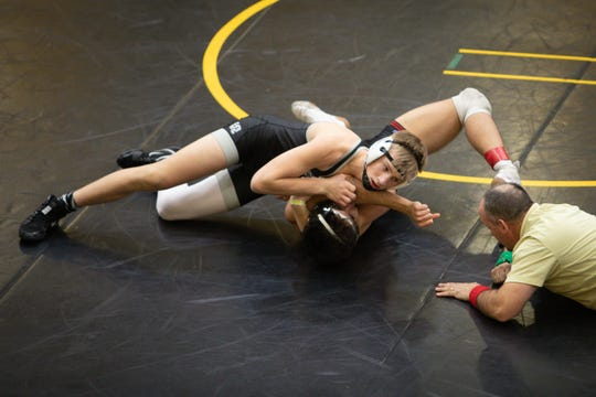 Ankeny Centennial's Eric Owens pins Mason City's Marcos Cervantes in the opening rounds of the CIML Invitational on Jan. 25 at Southeast Polk High School. Owens finished second, losing a 3-1 decision to Valley's Caleb Corbin in the 145-pound final.