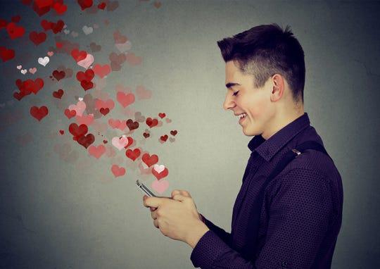 Man sending romantic text message