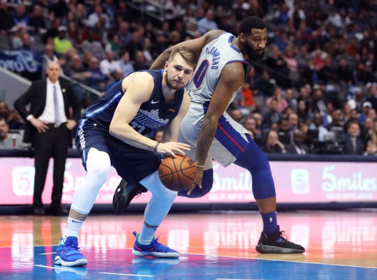 Dallas Mavericks forward Luka Doncic looks to score past Detroit Pistons center Andre Drummond during the first quarter Jan. 25, 2019 in Dallas.