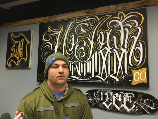 Tim Bullis is owner of Motown Tattoo Co. in Eastland Center mall on Jan. 24, 2019