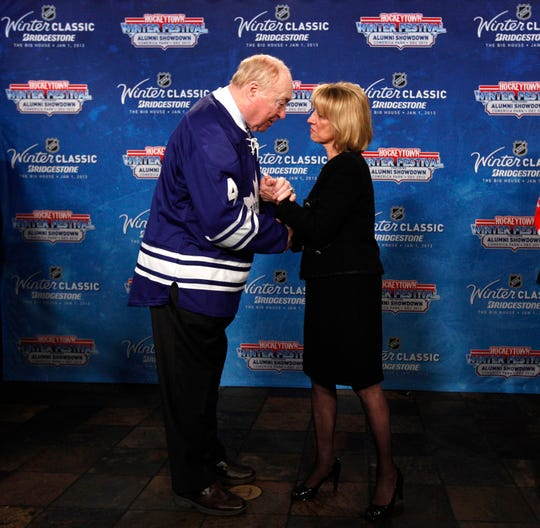 The Toronto Maple Leafs retired the No. 4 jersey of Red Kelly, shown here talking  with Detroit Red Wings owner Marian Ilitch in 2012.