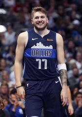 25. January 2019; Dallas, TX, USA; Dallas Mavericks striker Lukas Doncic (77) laughs in the second quarter against the Detroit Pistons at the American Airlines Center on Friday, January 25, 2019.