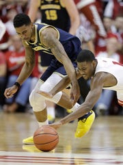 Michigan's Charles Matthews and Indiana's Aljami Durham chase a loose ball in the second half Friday, Jan. 25, 2019, Bloomington, Ind.