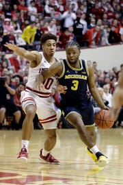 Michigan's Zavier Simpson drives against Indiana's Rob Phinisee during the first half Friday, Jan. 25, 2019, Bloomington, Ind.