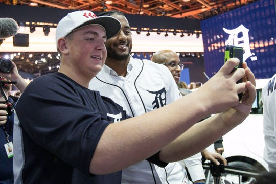 Brendan Dibartolomeo takes a selfie with Tigers' Niko Goodrum during the Detroit Tigers Winter Caravan at the 2019 North American International Auto Show at Cobo Center in Detroit on Friday, Jan. 25, 2019.