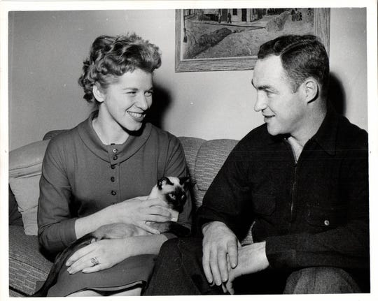 "Red Kelly, left, retired from hockey briefly in 1960 trying to avoid a trade to New York. He stated that he wanted to spend more time with his wife, Andra, and their cat, ""Wing."""