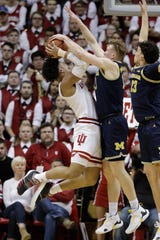 Indiana's Justin Smith has his shot blocked by Michigan's Ignas Brazdeikis during the first half Friday, Jan. 25, 2019, Bloomington, Ind.
