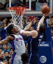 Dallas Mavericks forward Luka Doncic (77) drives to the basket against Detroit Pistons forward Stanley Johnson (7) during the first half of an NBA basketball game in Dallas, Friday, Jan. 25, 2019.
