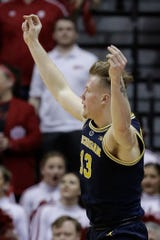 Michigan's Ignas Brazdeikis reacts after hitting a 3-pointer in the second half against Indiana, Friday, Jan. 25, 2019, Bloomington, Ind.