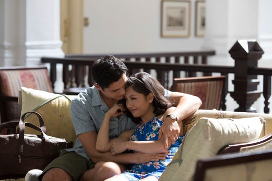 "Henry Golding, left, and Constance Wu in  ""Crazy Rich Asians."""