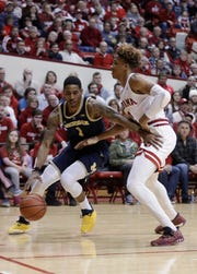 Charles Matthews dribbles against Indiana's Romeo Langford on Friday.