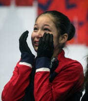 Alysa Liu reacts to her score in the ladies free skate at the 2019 U.S. Figure Skating Championships at Little Caesars Arena in Detroit, Friday, January 25, 2019.
