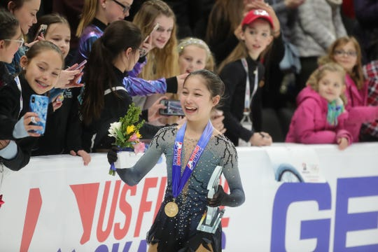 Alysa Liu poses with fans after winning the 2019 U.S. Figure Skating Championships at Little Caesars Arena in Detroit, Friday, January 25, 2019.