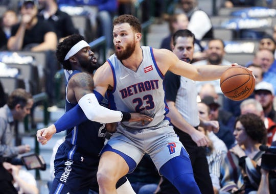 Detroit Pistons forward Blake Griffin posts up against Dallas Mavericks guard Wesley Matthews during the first quarter Jan. 25, 2019 in Dallas.