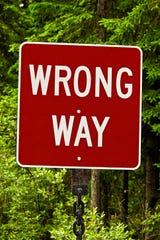 A red wrong way sign