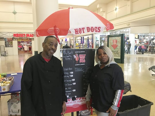 Renulda Pounds and James Keaton operate Holy Hotdogs inside Eastland Center mall