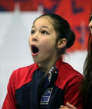 Alysa Liu reacts to her score during the ladies  2019 U.S. Figure Skating Championships at Little Caesars Arena in Detroit, Friday, January 25, 2019.