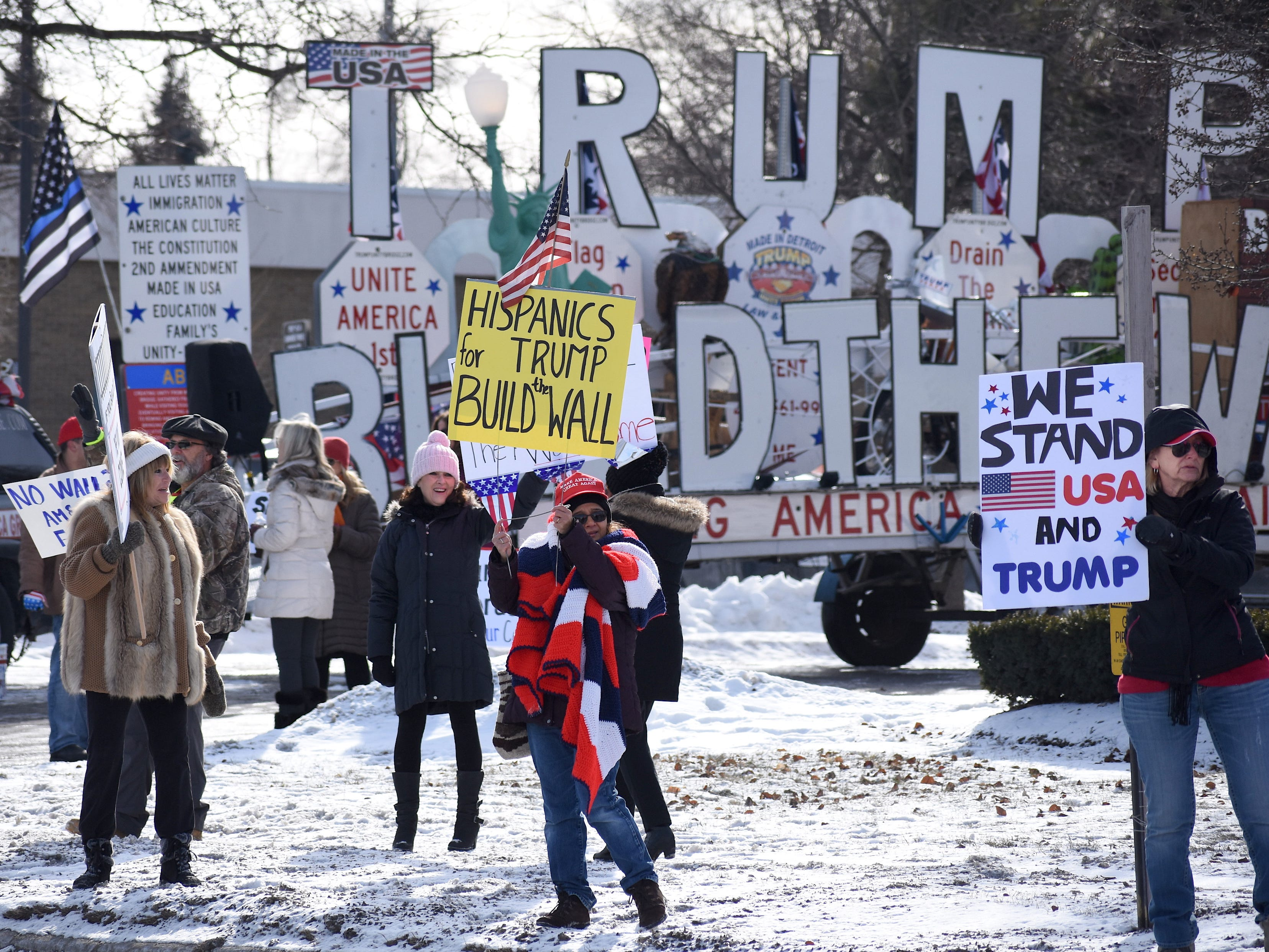 "About a hundred demonstrators line Woodward Avenue for a ""Build the Wall"" rally at the Oakland County Republican Party offices in Bloomfield Hills, Michigan on January 26, 2019."