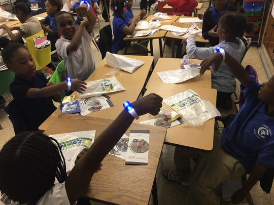 Students at Detroit's Carleton Elementary show off light-up bracelets last fall during a Walk to School Day event coordinated through Southeast Michigan Council of Governments and other groups. SEMCOG has been promoting pedestrian and safety education.