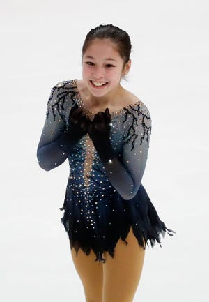 Alysa Liu reacts after performing her women's free skate program.
